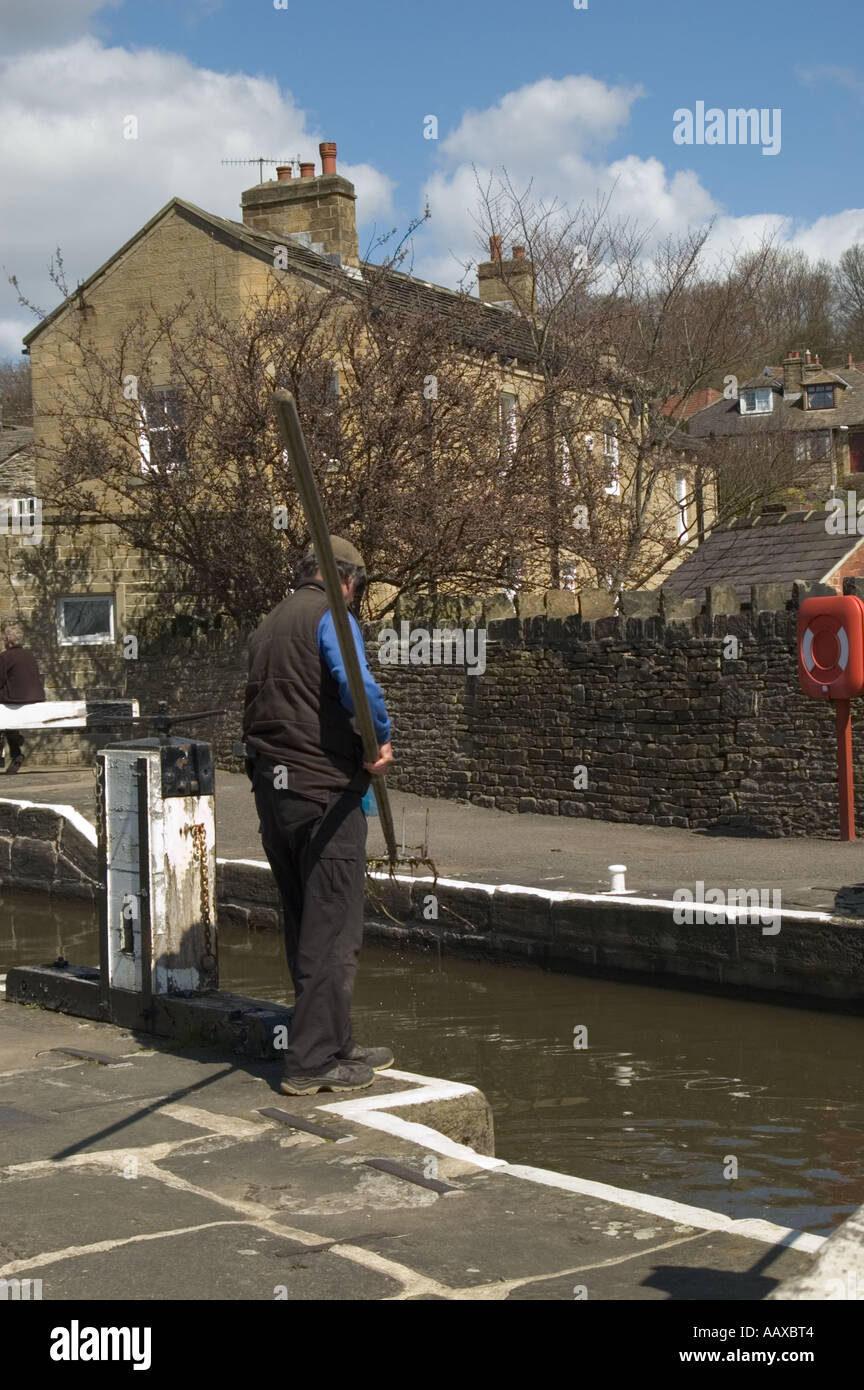 Lock keeper working on the Five Rise locks on the Leeds Liverpool Canal Near Keighley Yorkshire England. - Stock Image