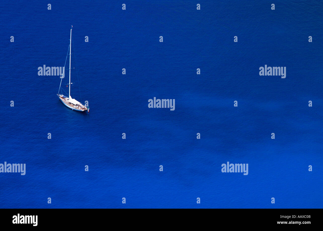Isolated photo of a yacht anchored in bay off Myrtos beach Kefalonia Ionian islands Greece Mediterranean Sea - Stock Image