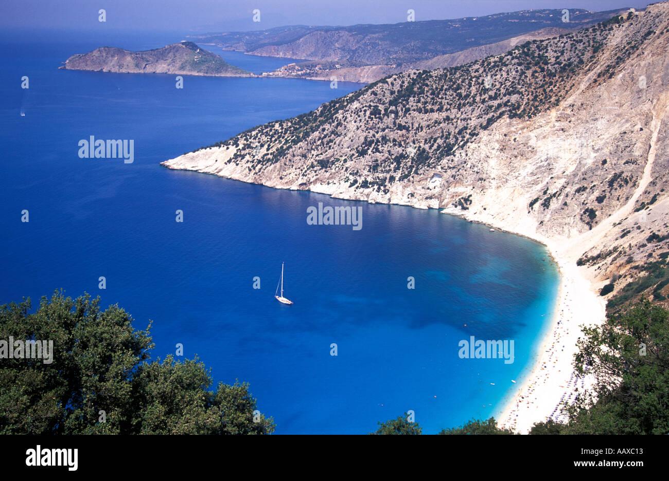 Yacht anchored in bay off Myrtos beach Kefalonia Ionian islands Greece Mediterranean Sea - Stock Image