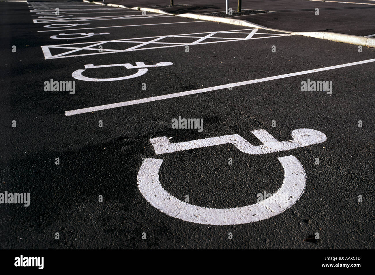 Disabled Parking Space in a car park. - Stock Image