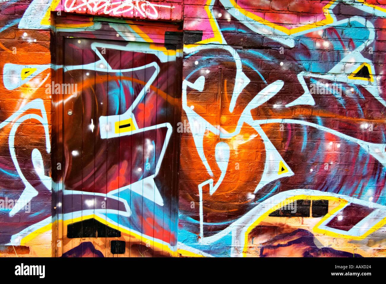 graffiti graffitti grafiti grafitti door wall brick art spray can modern urban tag tagging color colourful vandalsim youth cultu - Stock Image