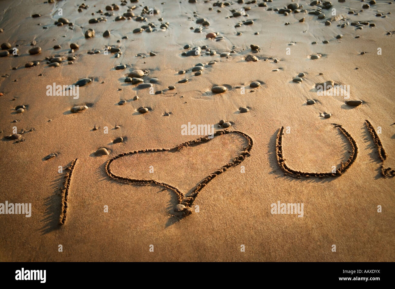 Writing in the sand: I love you - Stock Image