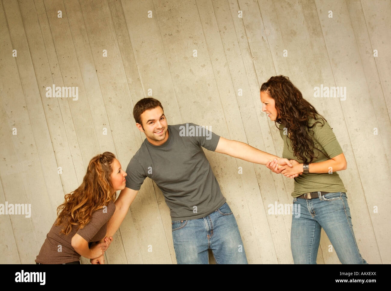 Women fighting over a man - Stock Image