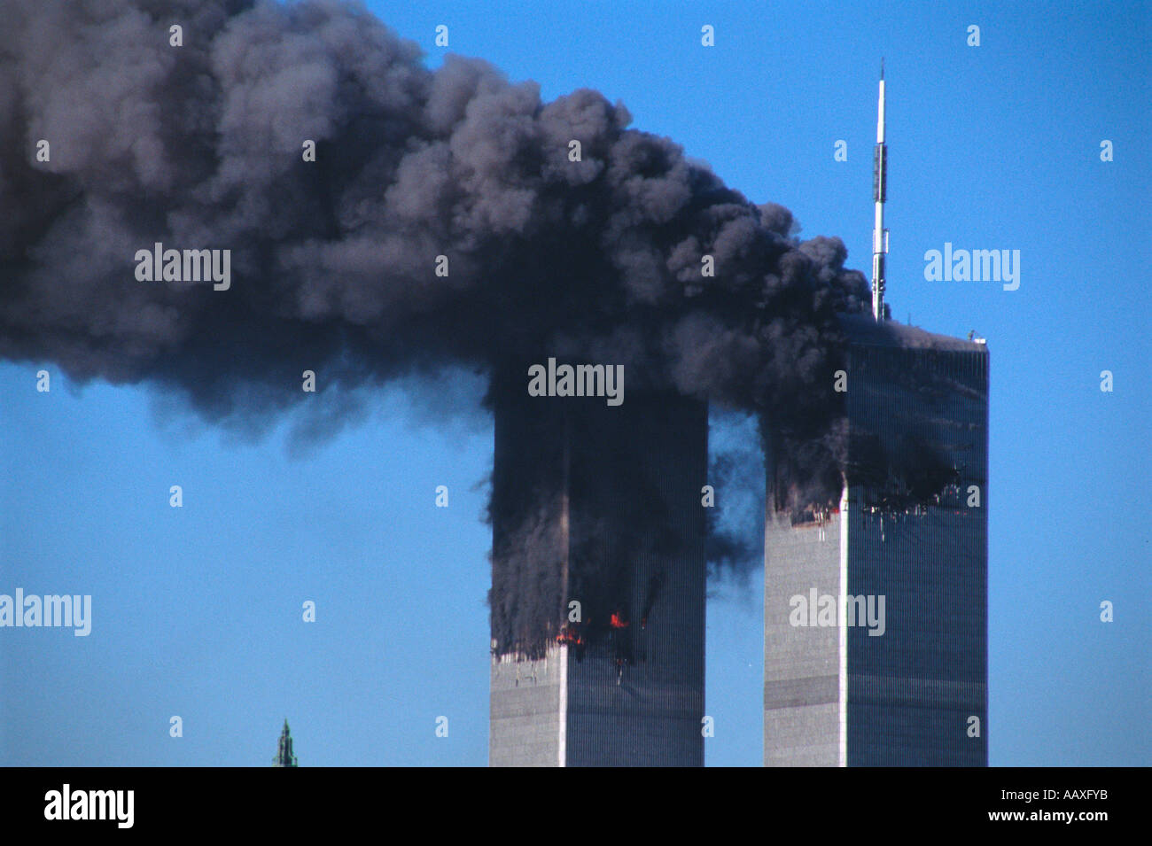 The world trade center standing with two gaping holes burning shortly after each building had been hit by and airliner. - Stock Image