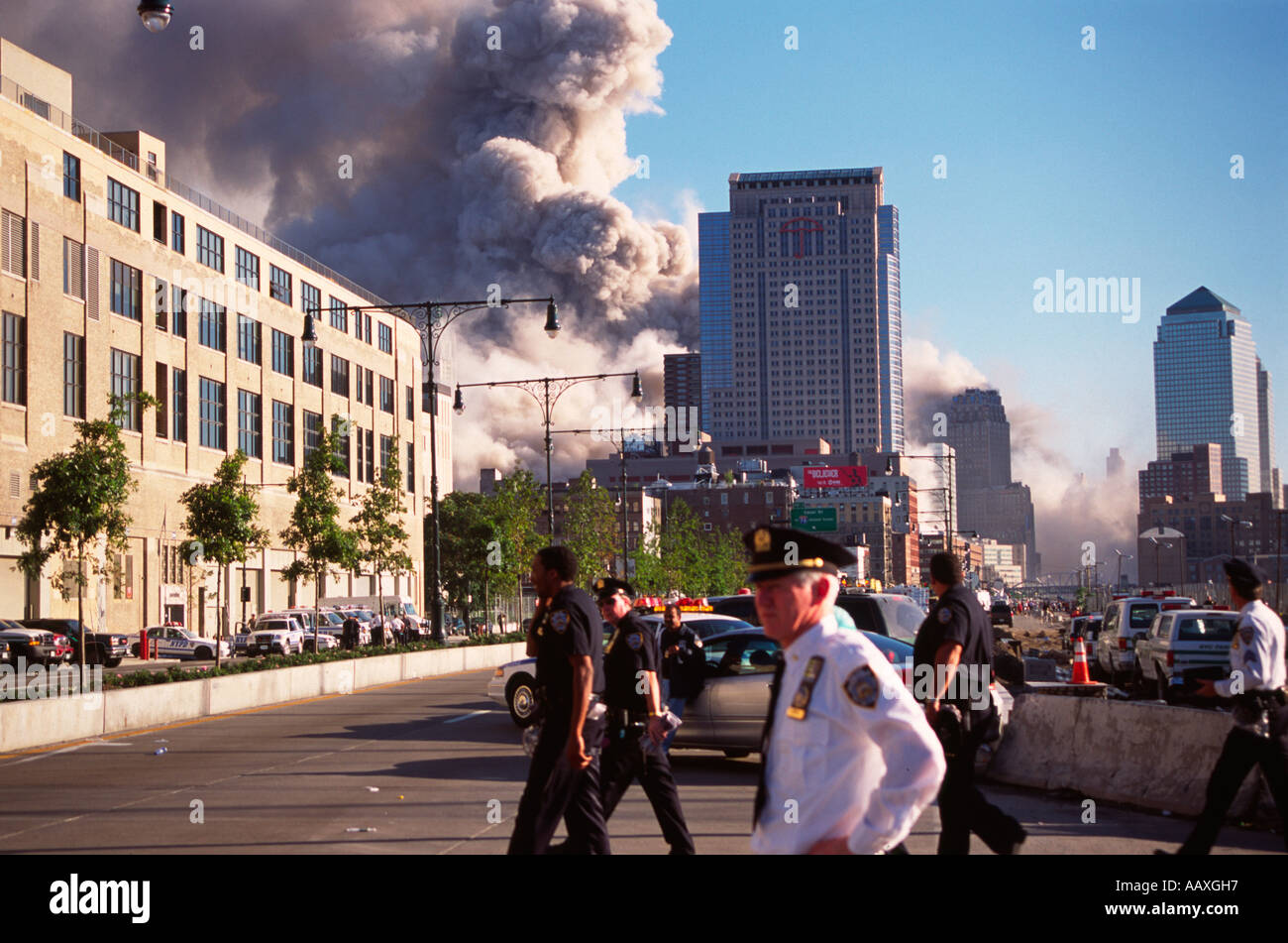 The collapse of the WTC 7 building on September 11th as seen from the west side highway in NYC. - Stock Image
