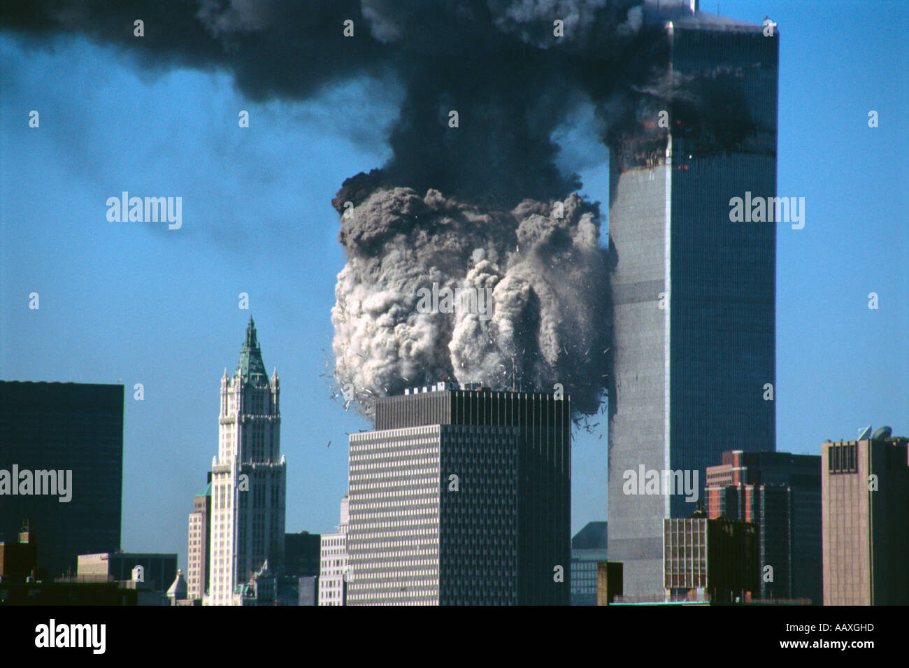 WTC (world trade center) 2 collapsing as WTC 1 still stands behind it in NYC on September 11th, 2001. - Stock Image