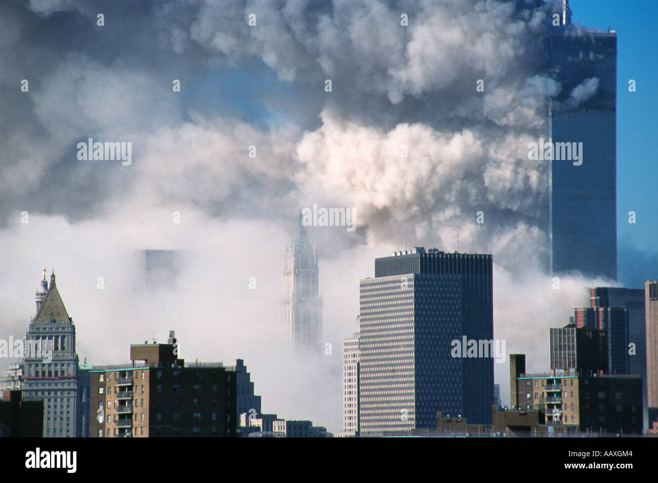 World trade center collapse on September 11th, 2001. The South Tower (WT2) is collapsing with the North tower (WTC1) behind NYC - Stock Image