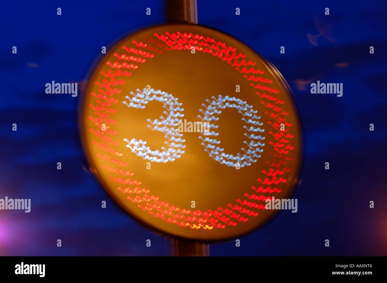 30 speed limit enforcement sign - Stock Image