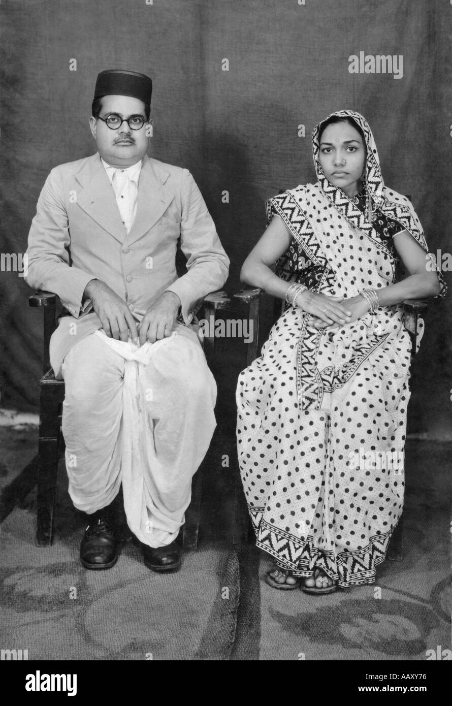 Indian couple old photo sitting on chair village mahangwa district narsinghpur madhya pradesh india model