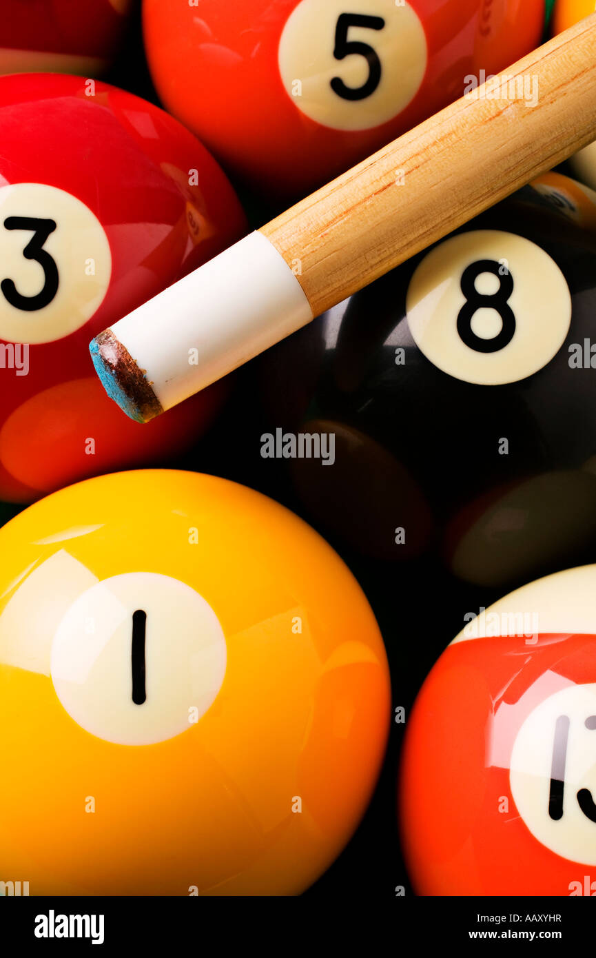 Pool balls and cue stick Stock Photo