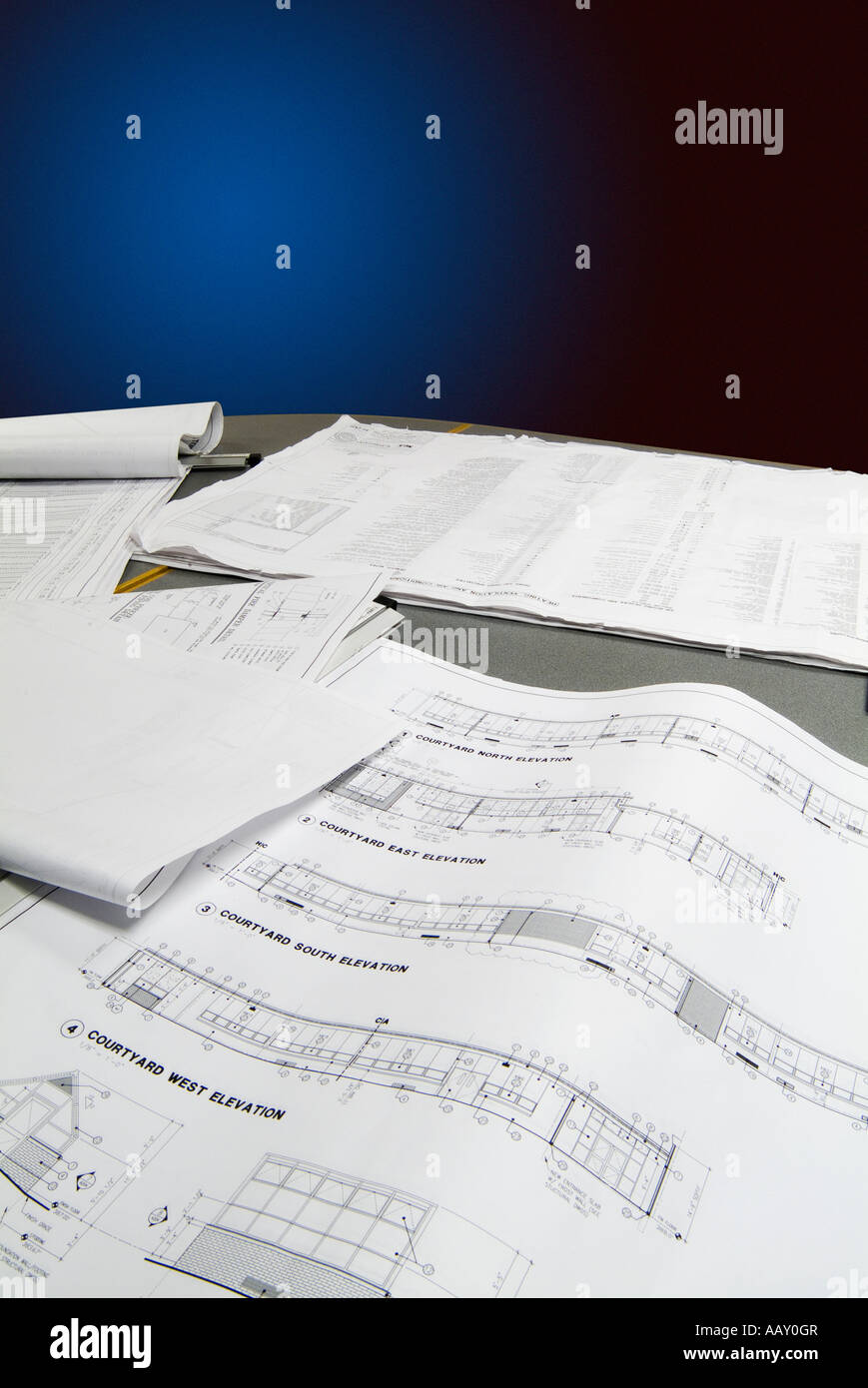 Architectural blueprint drawings of building on table studio still architectural blueprint drawings of building on table studio still life usa malvernweather Gallery