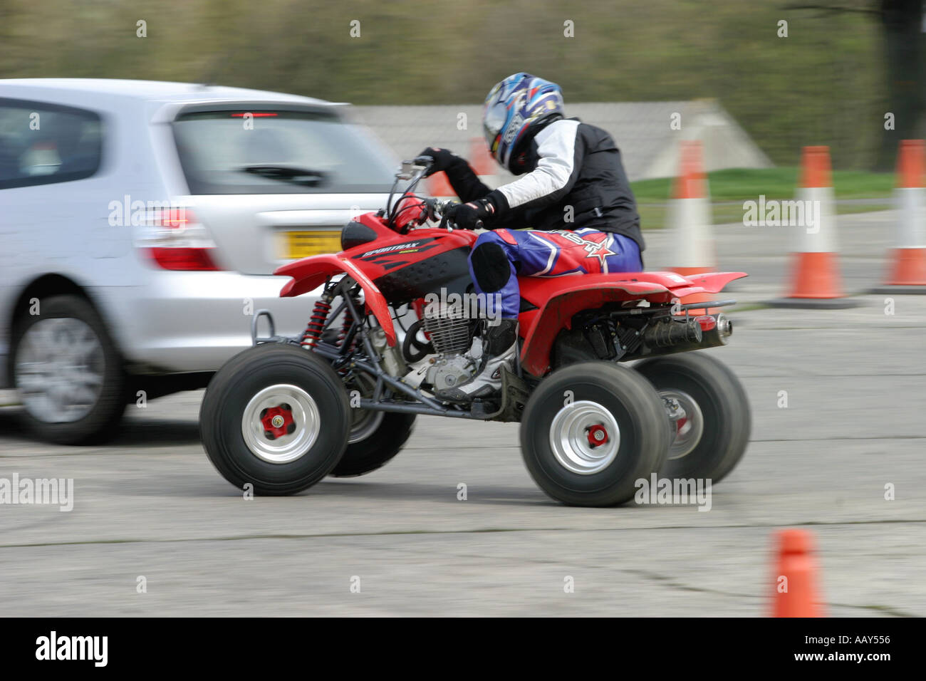 A stuntman puts a quad bike through its paces - Stock Image