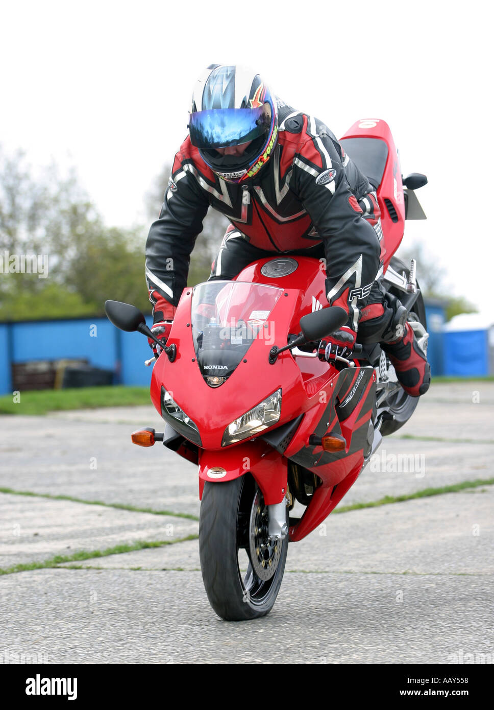 A stuntman pulls a stoppie on a Honda CBR600RR motorcycle - Stock Image