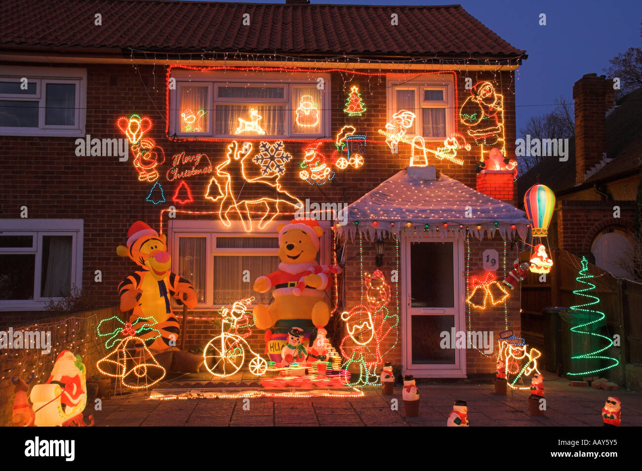 house with christmas decorations on house - Stock Image