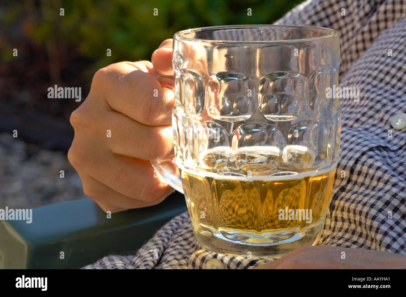 Lager beer being held in a traditional british pint pot - Stock Image