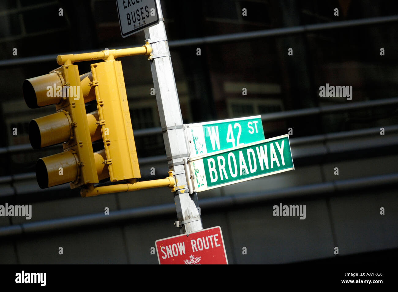 Street signs spotlit by sun at intersection of Broadway and Forty Second 42nd street, Times square, New York City - Stock Image
