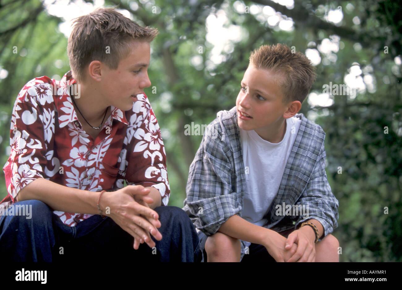 Two teenage boys talking together Stock Photo: 7274096 - Alamy
