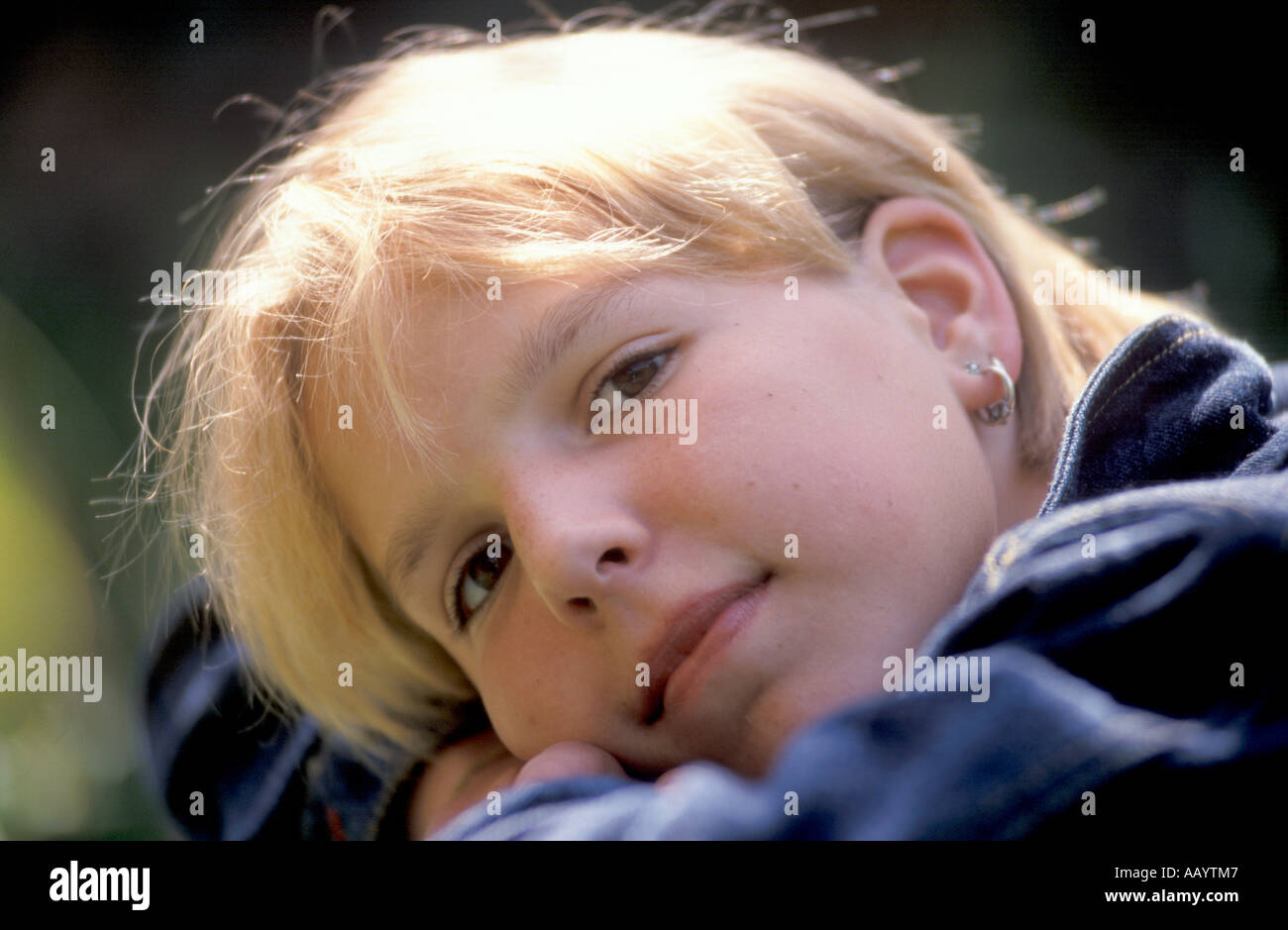 Pondering teenage girl - Stock Image