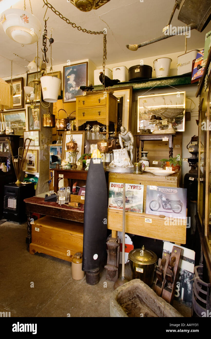 Typical crowded antiques store interior England UK - Stock Image