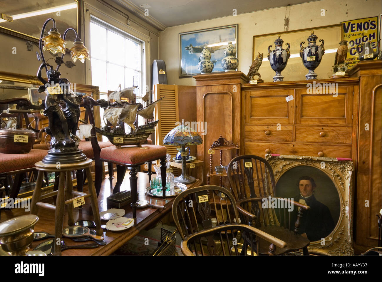 Antiques shop store interior England UK - selling antique and vintage furniture and ornaments - Stock Image