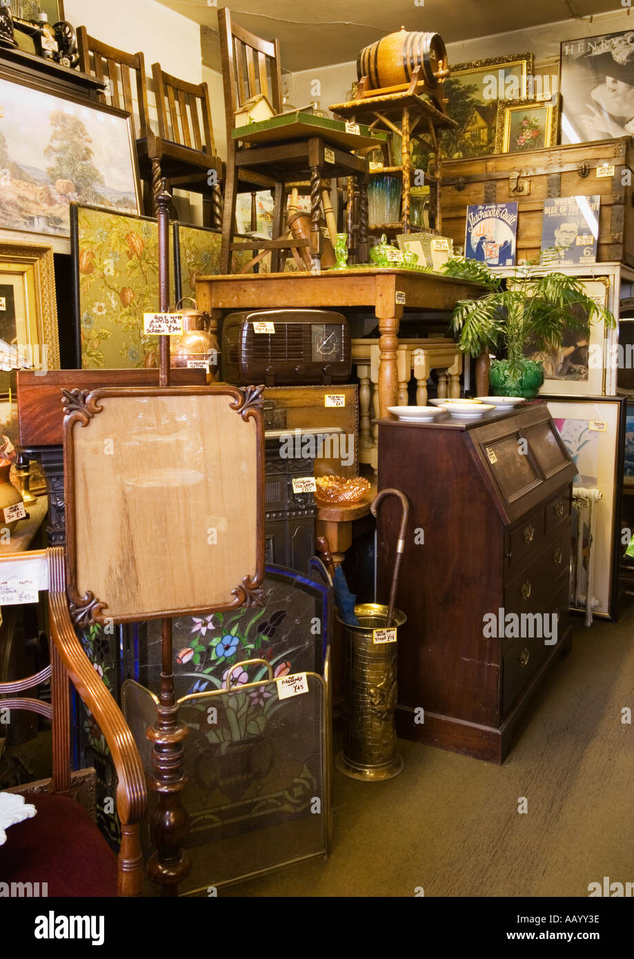 Furniture in an antique store interior England UK - Stock Image