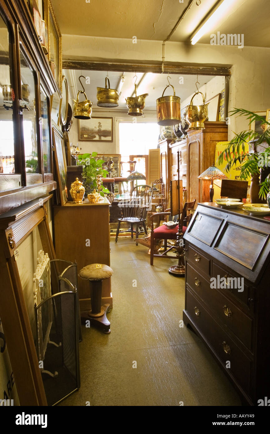 Antiques store shop interior with old furniture, England UK - Stock Image