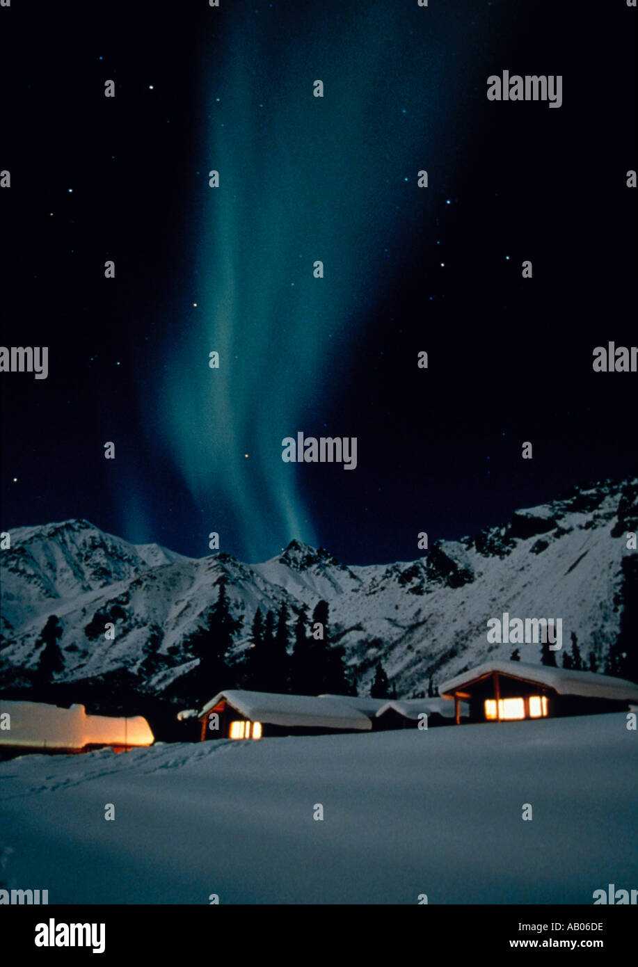 Aurora Borealis norther lights and cabins in the snow AK - Stock Image