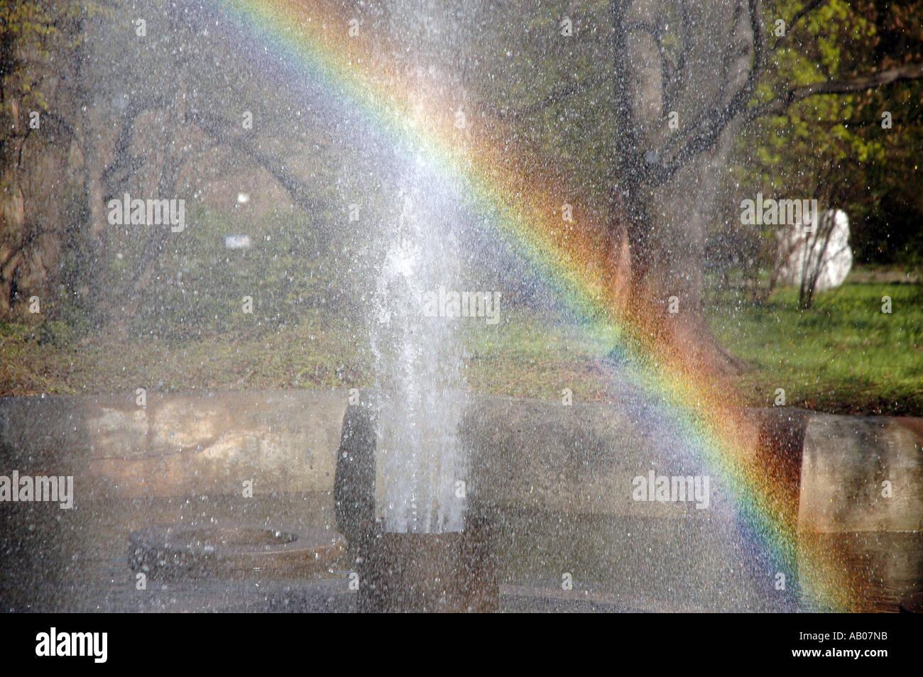 Rainbow from fountain - Stock Image