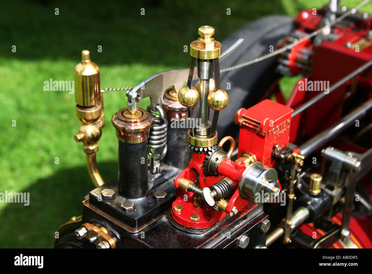 Steam and revolution controller gear on a scale model steam traction engine. - Stock Image