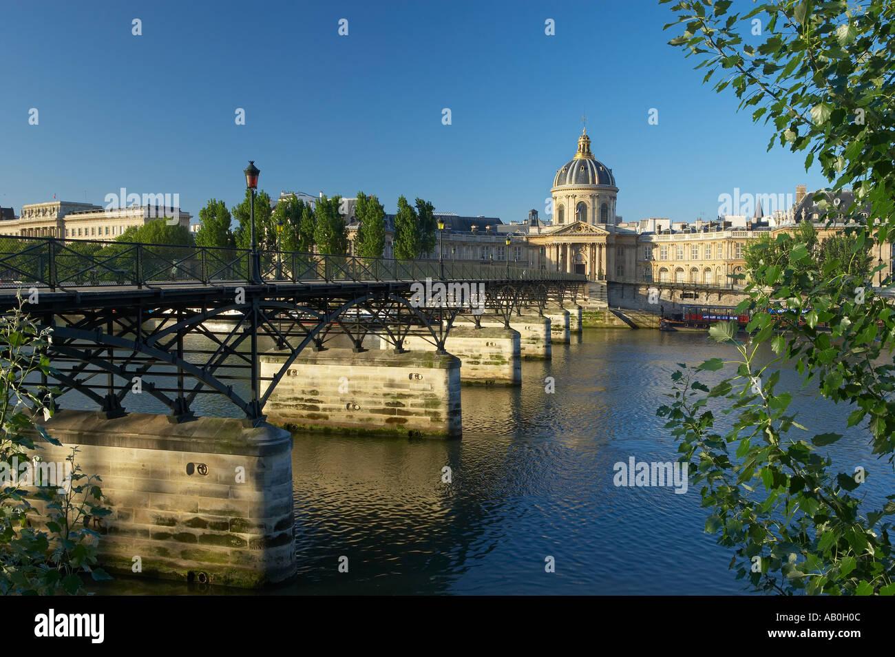 The Pont des Arts over the River Seine with the Instituit de France beyond Paris France - Stock Image