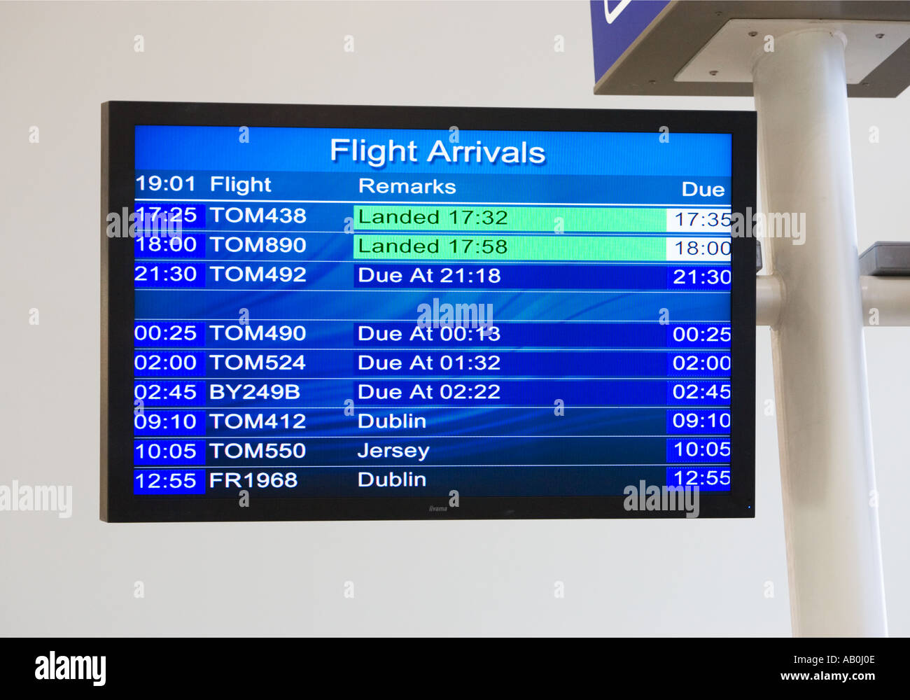 Flight Arrivals electronic notice board at a small UK Airport - Stock Image