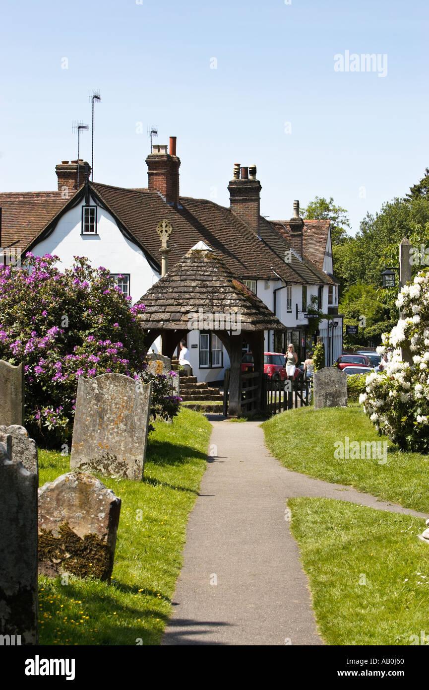 The churchyard of St James, Shere, Surrey, England, UK - Stock Image