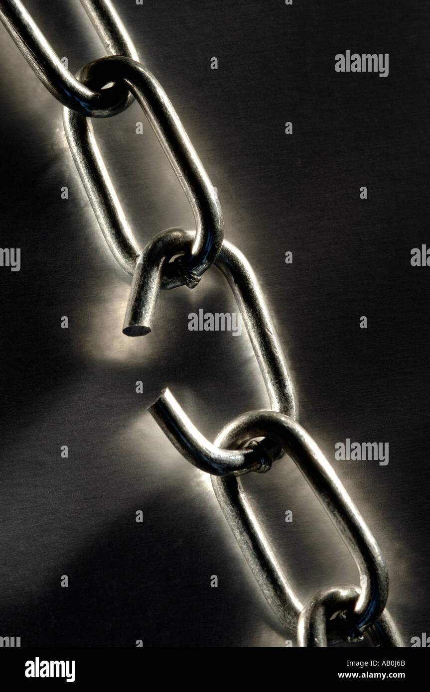 Broken link in a chain - Stock Image
