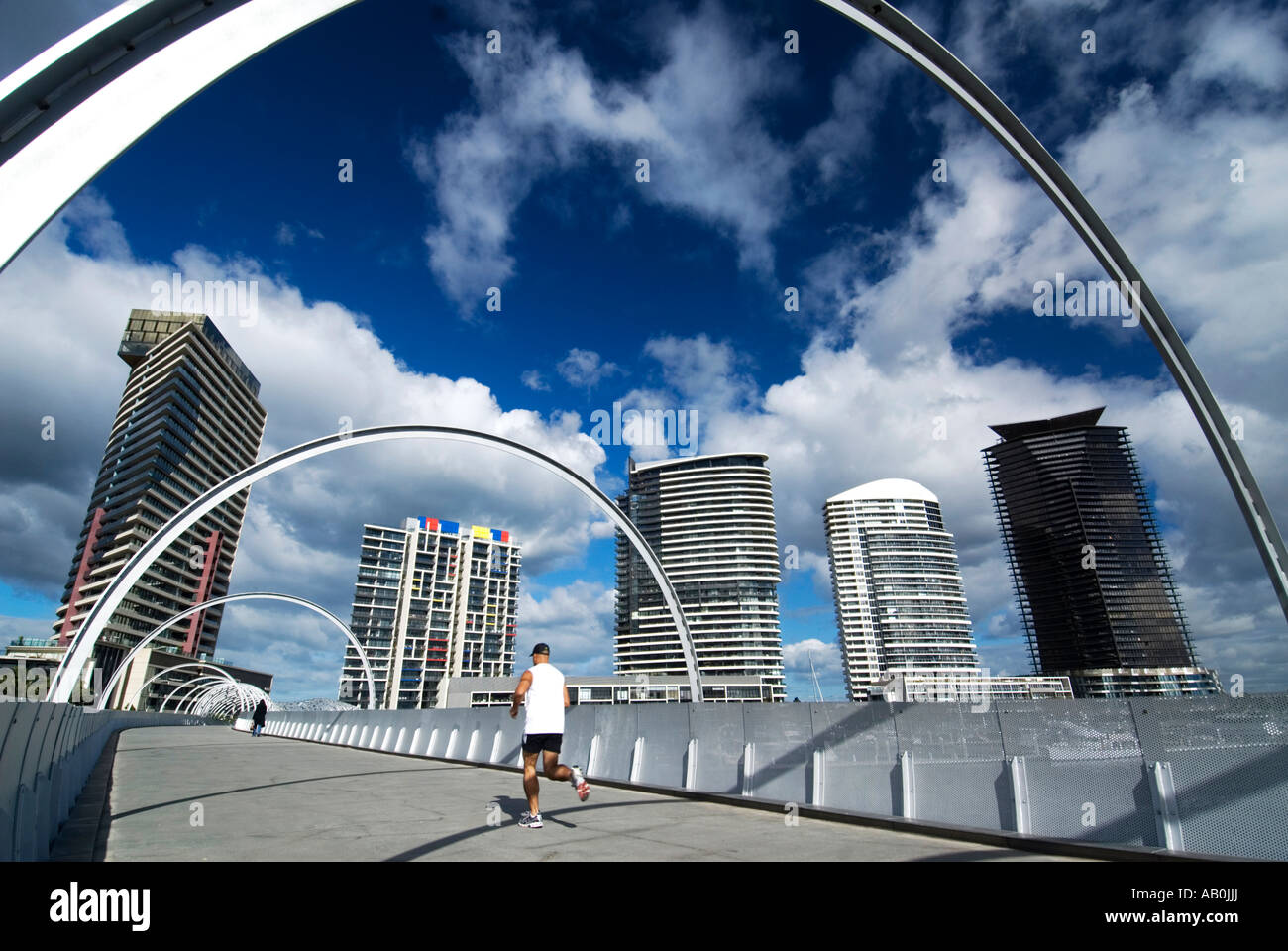 View of spectacular steel Webb Bridge over Yarra River and new apartment buildings in Docklands Melbourne Australia - Stock Image