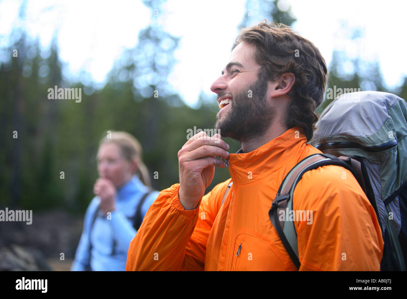 Couple gearing up for hiking trip - Stock Image