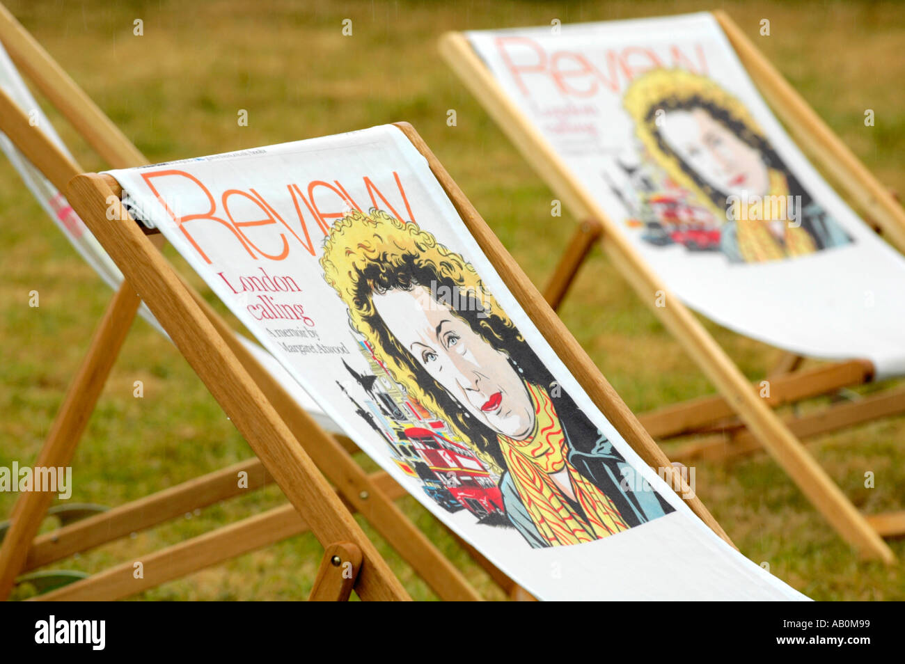 Promotional deckchairs with graphic of Margaret Atwood on The Guardian Hay Festival 2005 site Hay on Wye Powys Wales UK - Stock Image