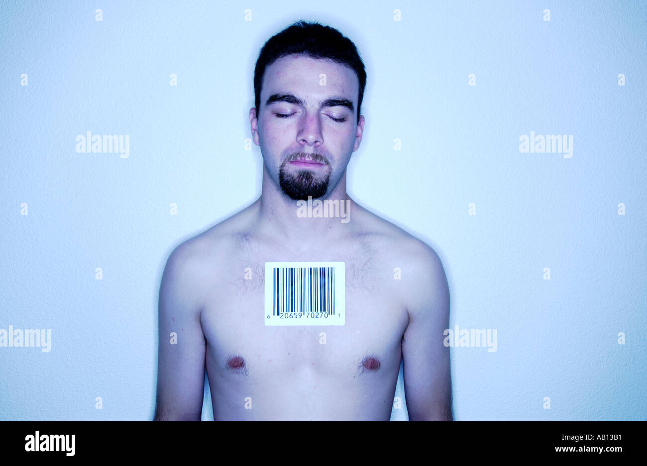 Man with barcode label on chest - Stock Image