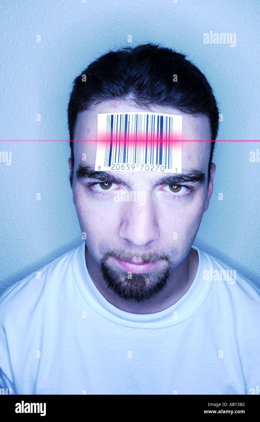 Man with barcode label on forehead getting scanned - Stock Image