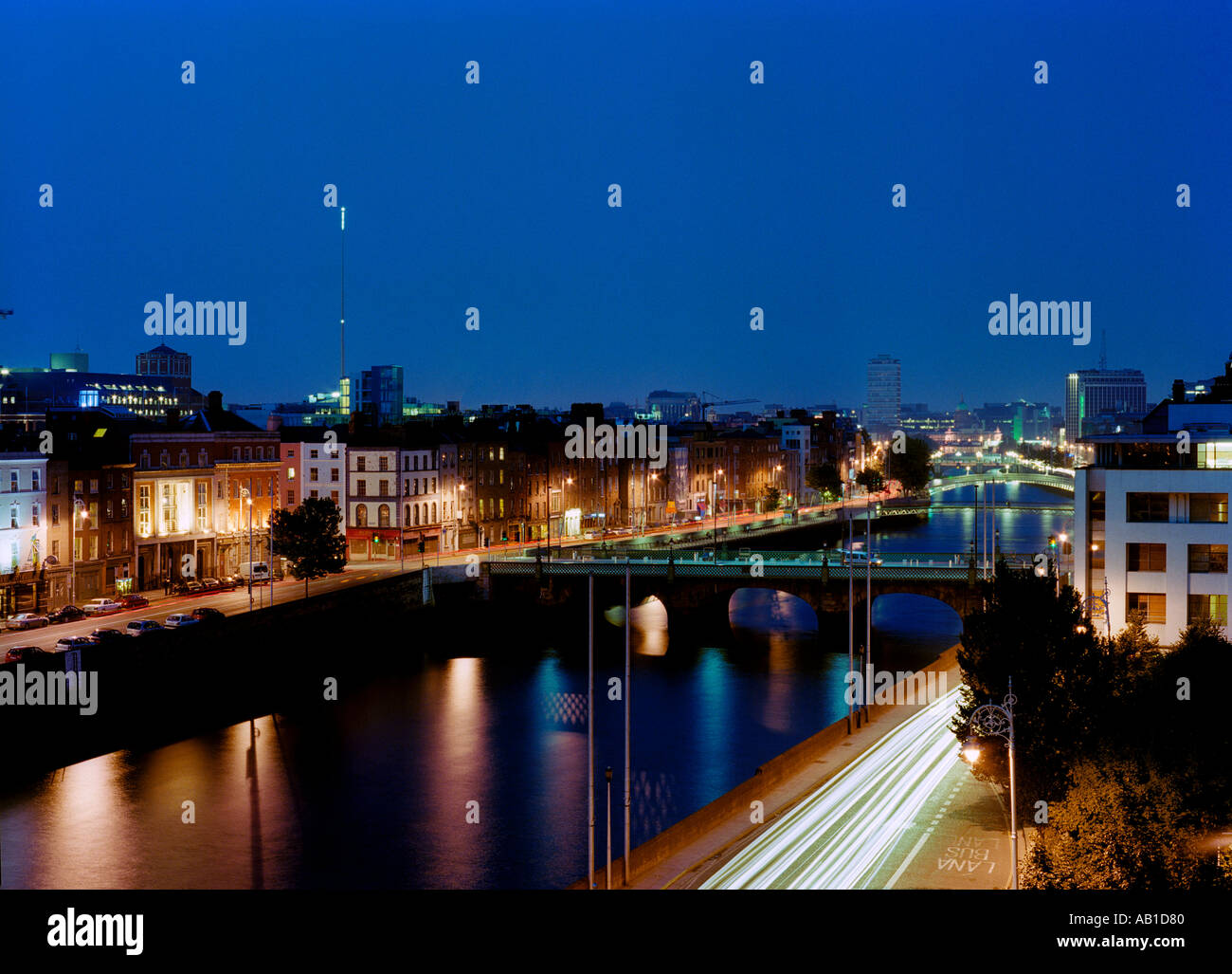 An evening scene of the river Liffey in Dublin, Ireland,  including the Spire of Dublin - Stock Image