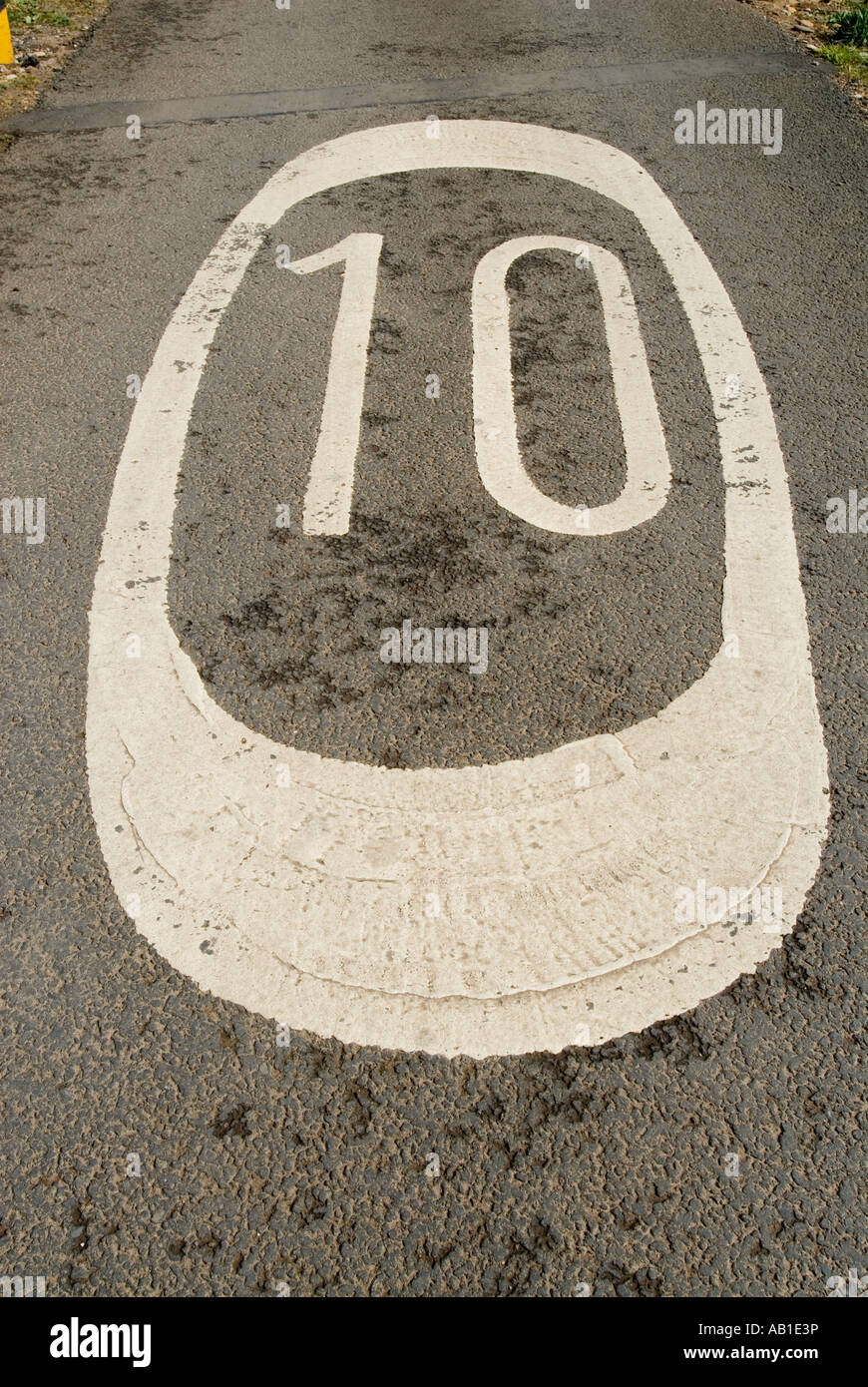 speed limit marking on road - Stock Image