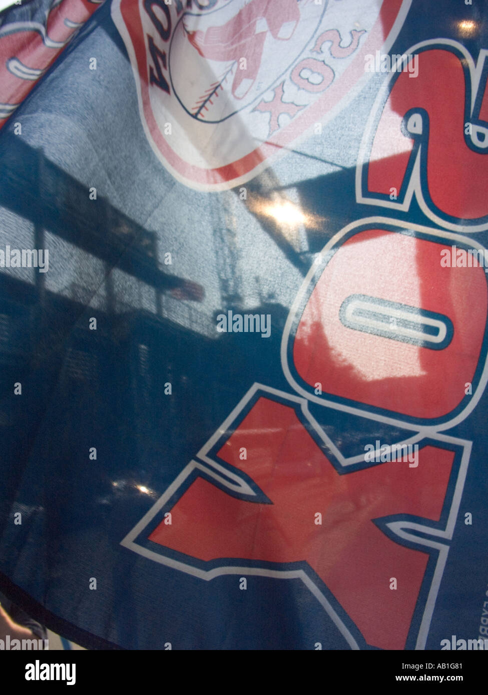 Red Sox team flag hangs outside Fenway Park Baseball stadium on a game day - Stock Image