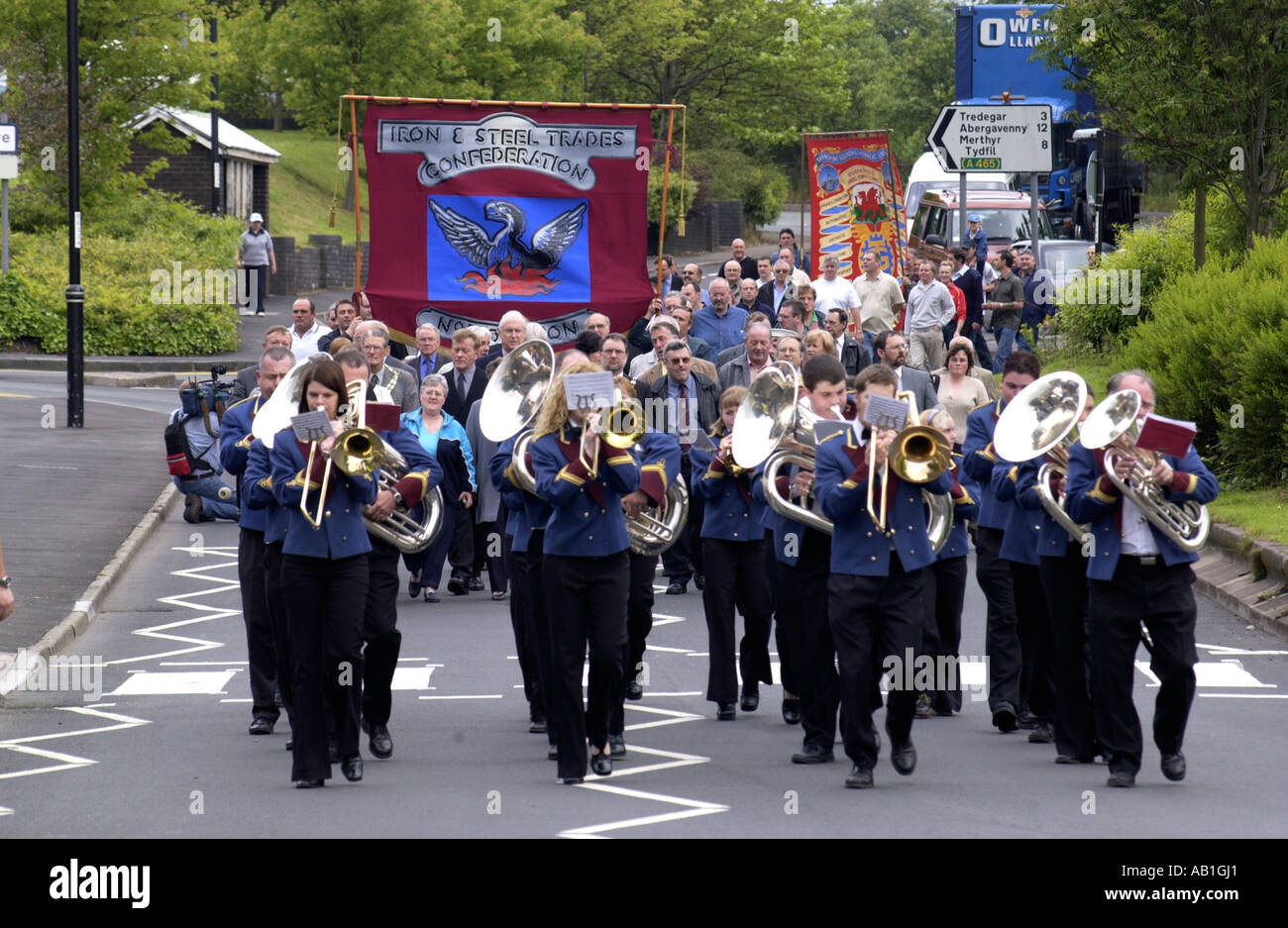 Workers and their families march under trade union banners and led by a brass band from Corus Ebbw Vale tinplate works Wales UK - Stock Image