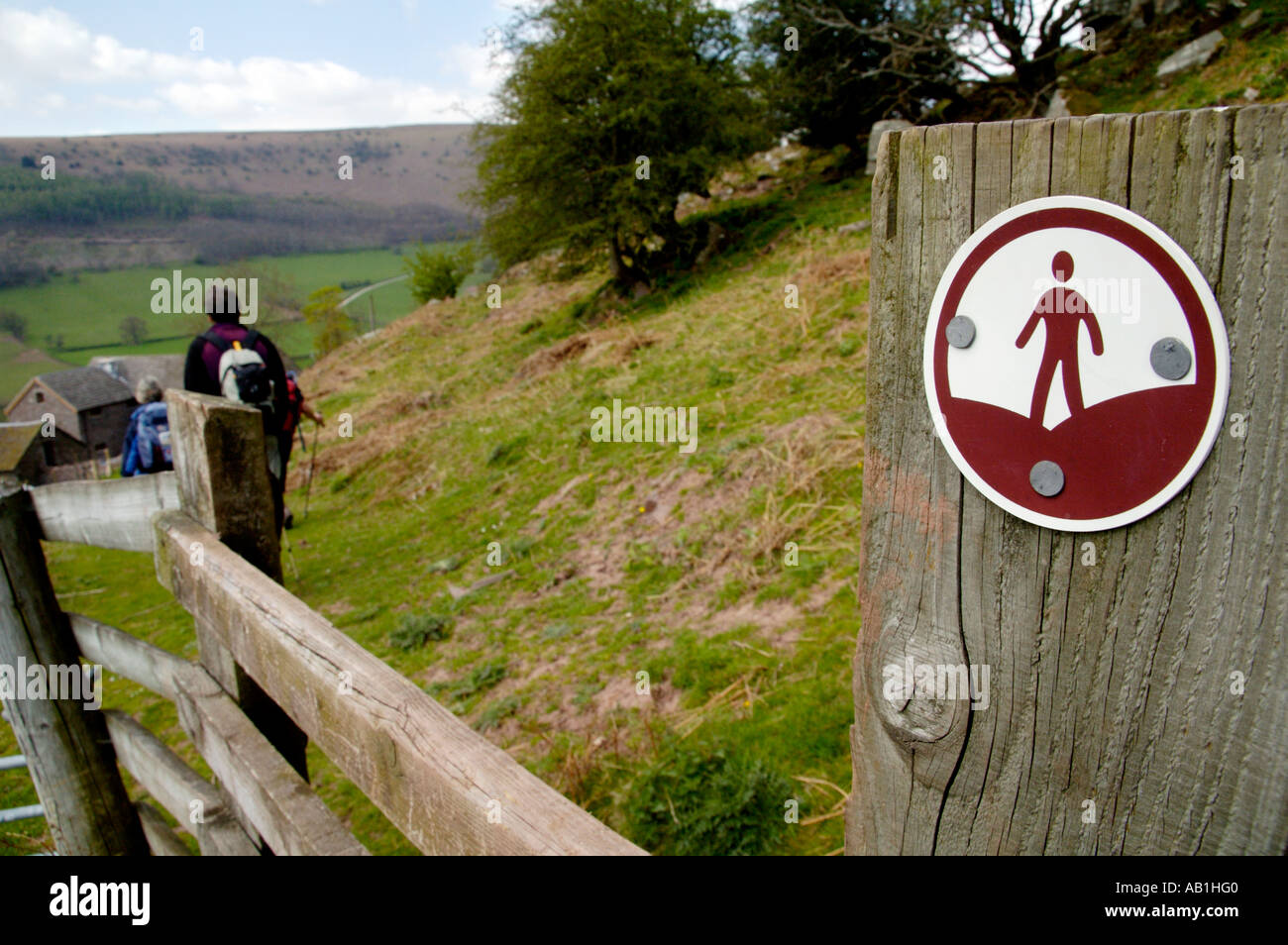 CROW Countryside and Rights of Way sign on footpath with people walking in Vale of Ewyas Monmouthshire South Wales UK - Stock Image