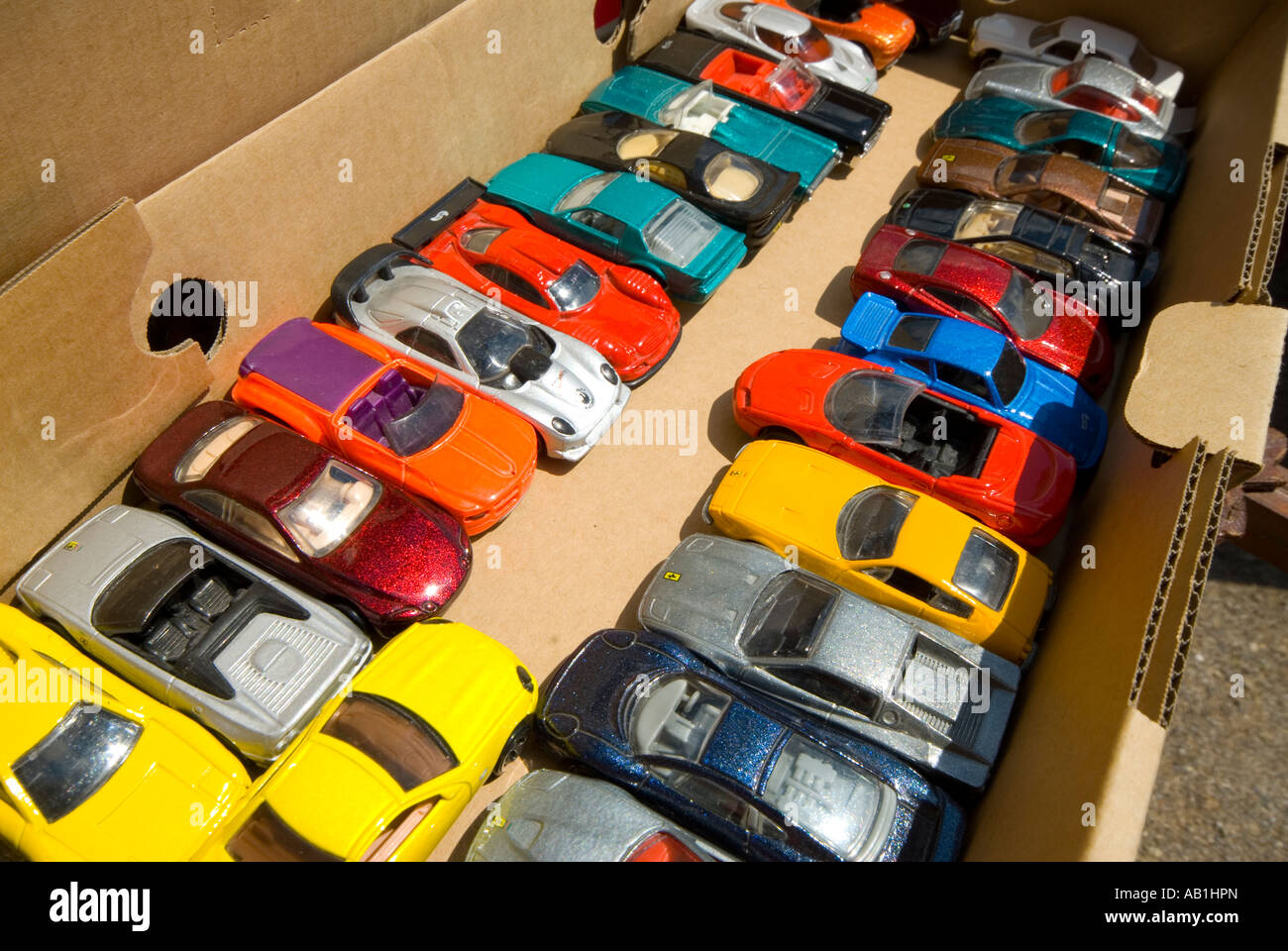 model cars in cardboard box - Stock Image