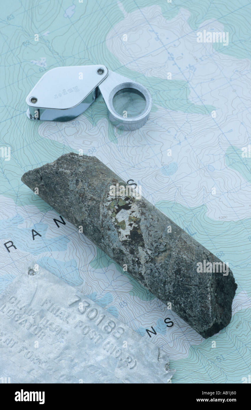 Mining  concept map drill core sample old claim sign and magnifier - Stock Image