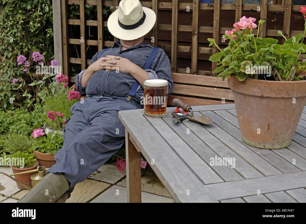 Having a nap in the summer garden 2 - Stock Image