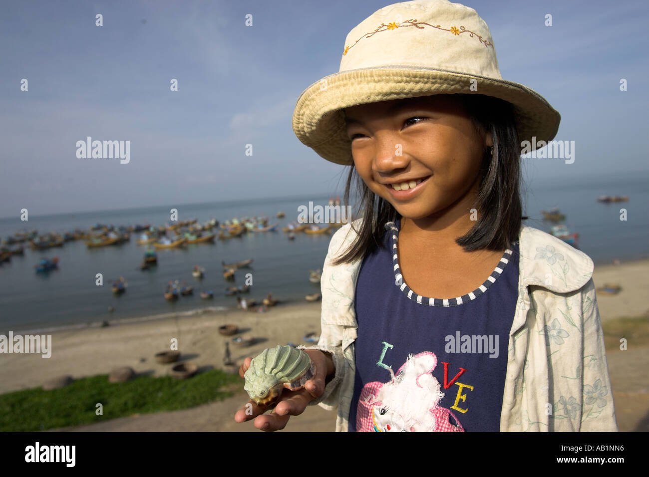 Young girl selling sea shells at Lang Chai fishing village near Mui Ne Vietnam Stock Photo