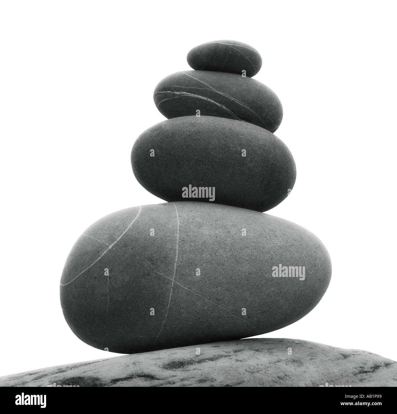 stones balanced on top of each other - Stock Image