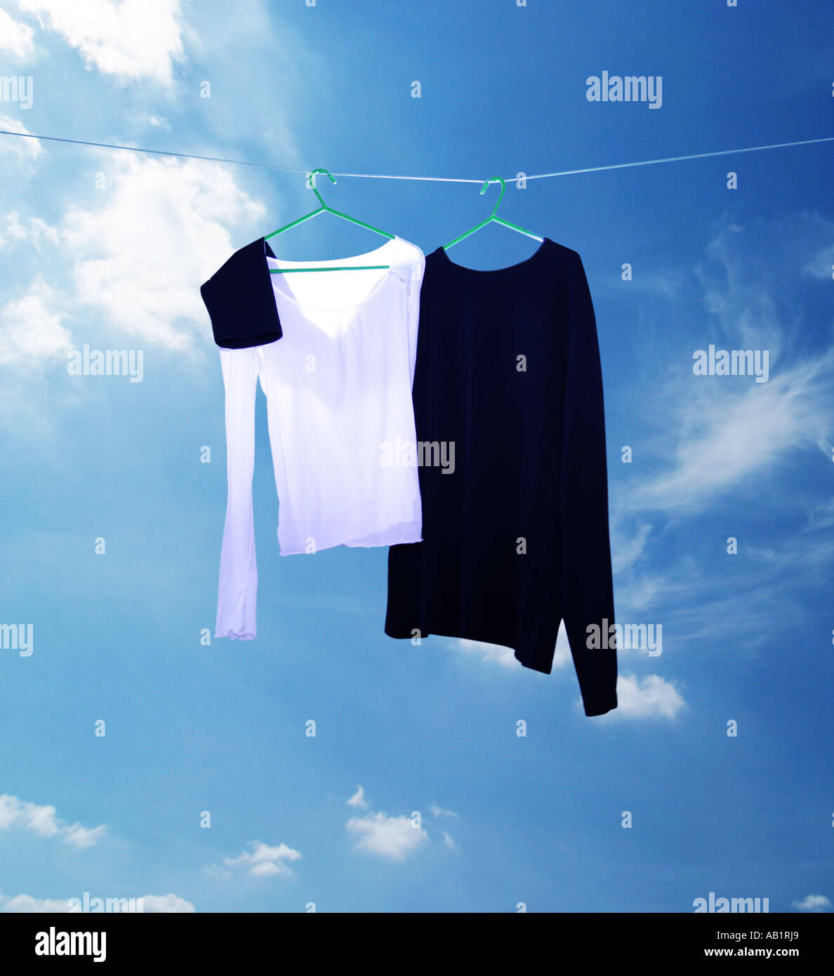 two tops on a washing line - Stock Image