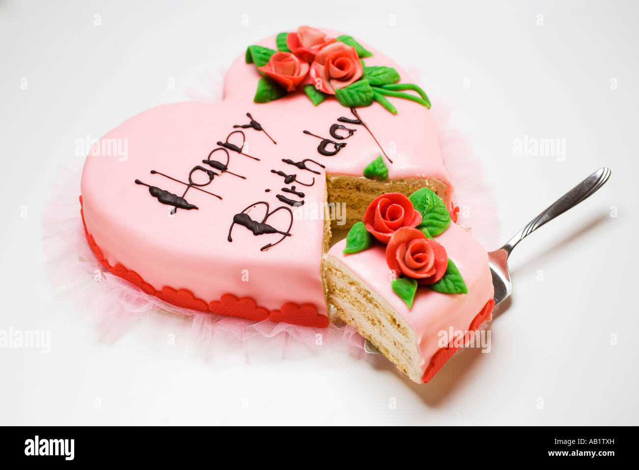 Pink Heart Shaped Birthday Cake With Piece On Server Foodcollection
